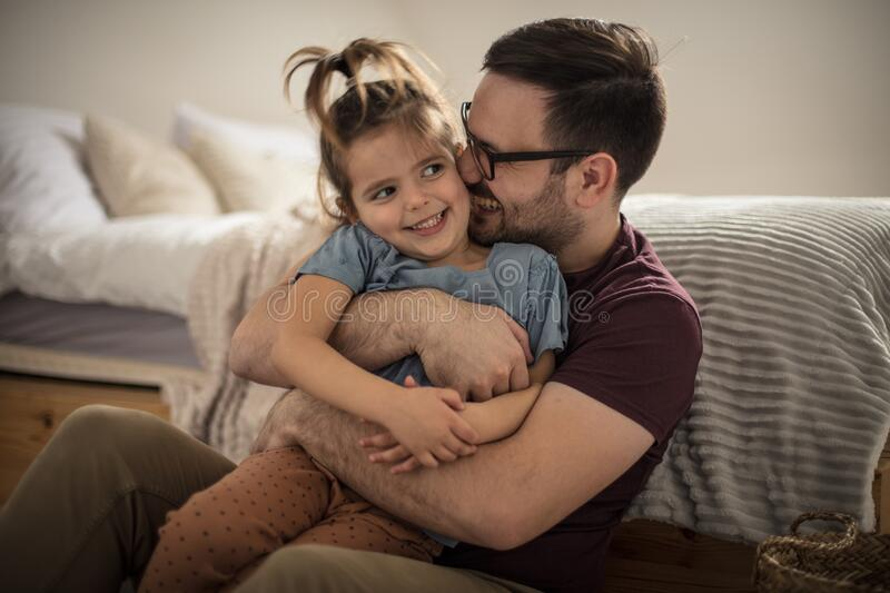 The joys of parenthood. Father and daughter having fun at home stock photography