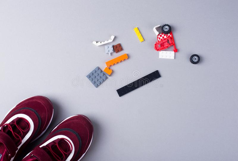 Joystick for games, controllers for games, designer, sports shoes. Flat lay stock photos