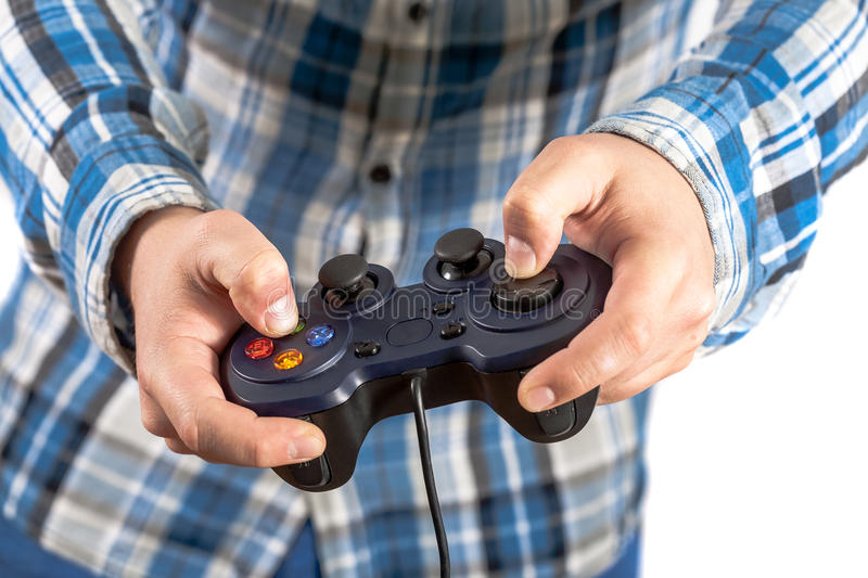 Joystick in hands. He like play and win video games royalty free stock photo