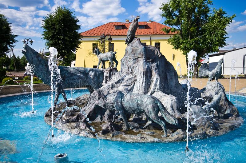 Jozefow, Poland: town centre fountain with animals monument royalty free stock image
