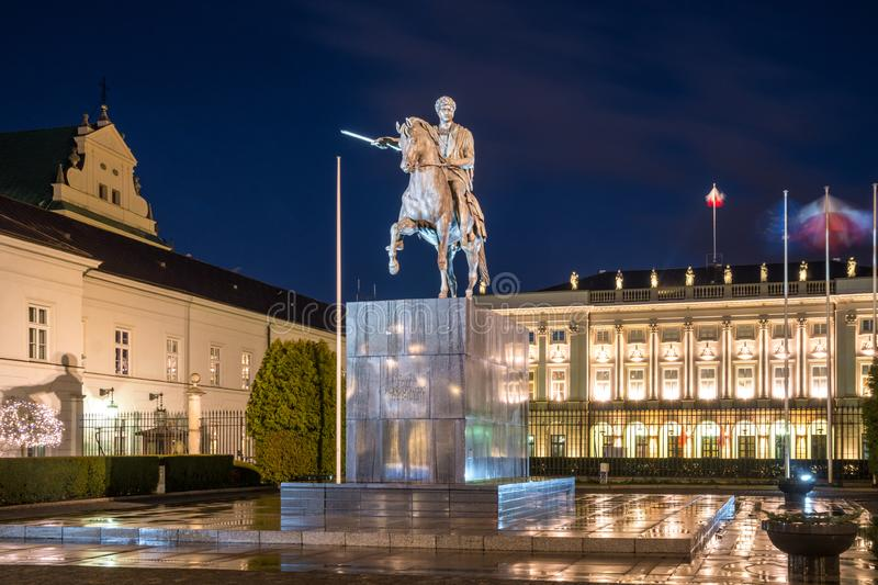 Jozel Poniatowski Sculpture in front of the Namiestnikowski Palace Residence of the President of the Republic of Poland in Warsaw. At night. Travel stock photography