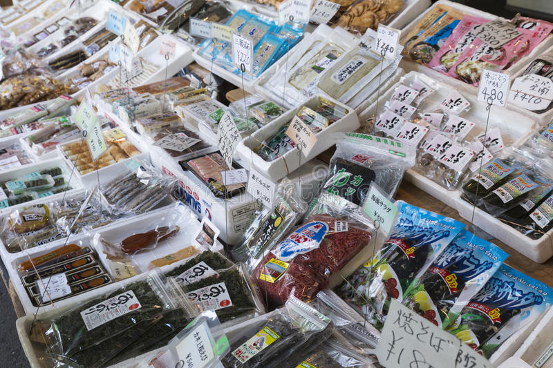 Fresh seafood and cooking ingredients on display at the Tsukiji fish market in Tokyo Japan stock photography