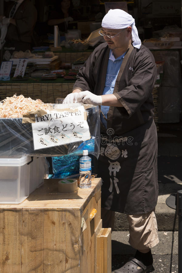 Street sales at the tsukiji fish market in tokyo japan. The outer market at the tsukiji fish market in Tokyo, Japan. Tradesmen prepare fresh seafood (e.g stock image