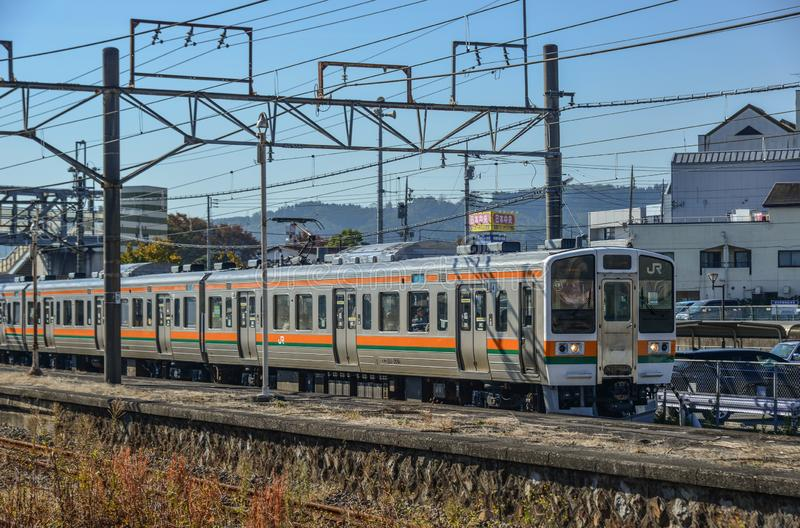 JR Station in Nagoya, Japan. Nagoya, Japan - Nov 10, 2019. A local train coming to JR Station in Nagoya, Japan. Trains are a very convenient way for visitors to royalty free stock photos
