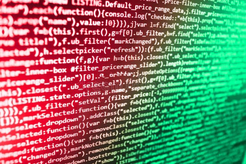 Js和抽象背景 在黑暗的屏幕上的编程的文本 来源个人计算机网站开发商 数据优化 程序员编制程序 免版税库存照片