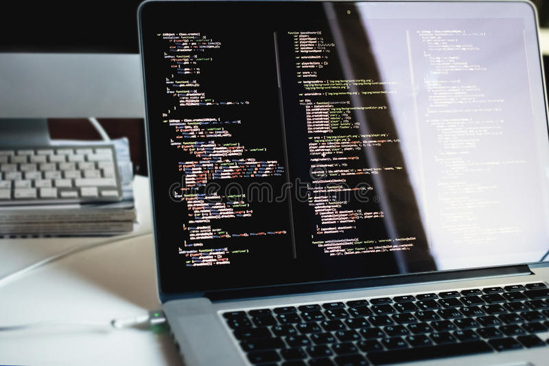 Js code on laptop screen, web development stock image