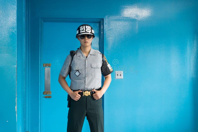 JSA within DMZ, Korea - September 8 2017: UN soldier in blue building at North South Korean border from the front guarding the doo royalty free stock photo