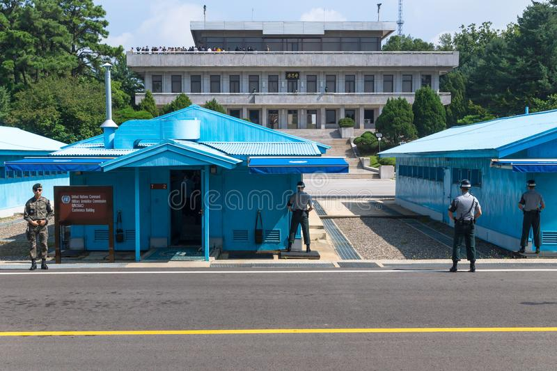 JSA within DMZ, Korea - September 8 2017: UN soldiers close in front of blue buildings at North South Korean border with North Kor stock photography