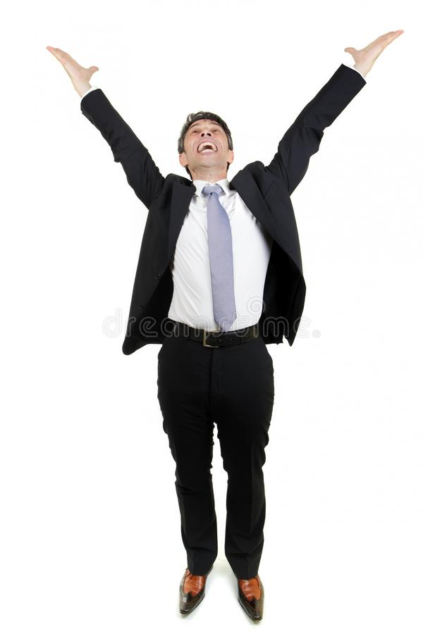 Jubilant businessman rejoicing. An achievement stretching his arms in the air and cheering in excitement and elation, full body portrait isolated on white stock photography
