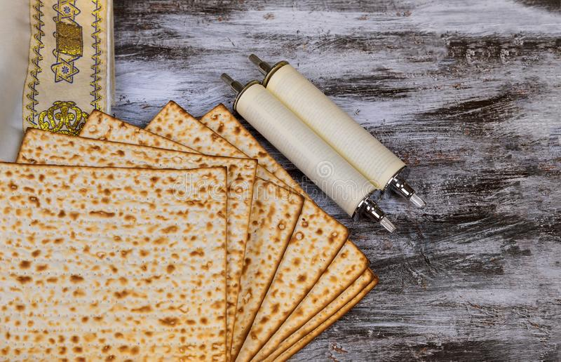 Judaism and religious torah on jewish matza on passover tallit. Prayer holiday unleavened bread seder celebration religion kosher matzo symbol matzah pesach stock photo
