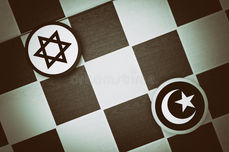 Judaism vs Islam. Draughts Checkers - Judaism vs Islam - religious tension and conflict between two monotheistic religions and believers, jews and muslims stock images