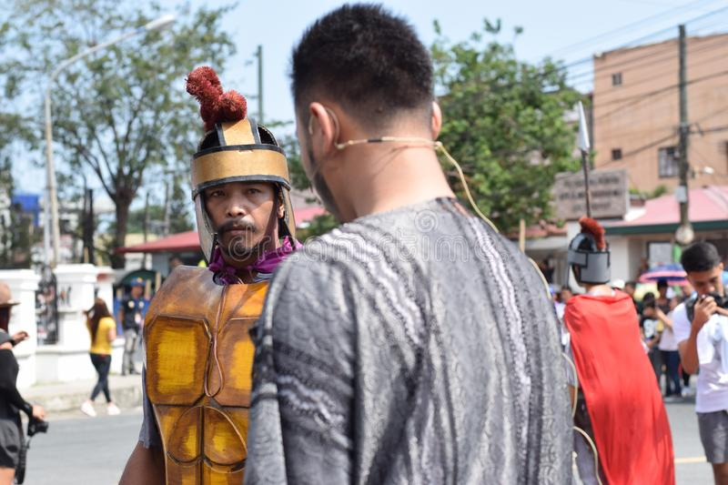 Judas iscariot confronted by rude roman soldier, street drama, community celebrates Good Friday representing the events that led t stock image