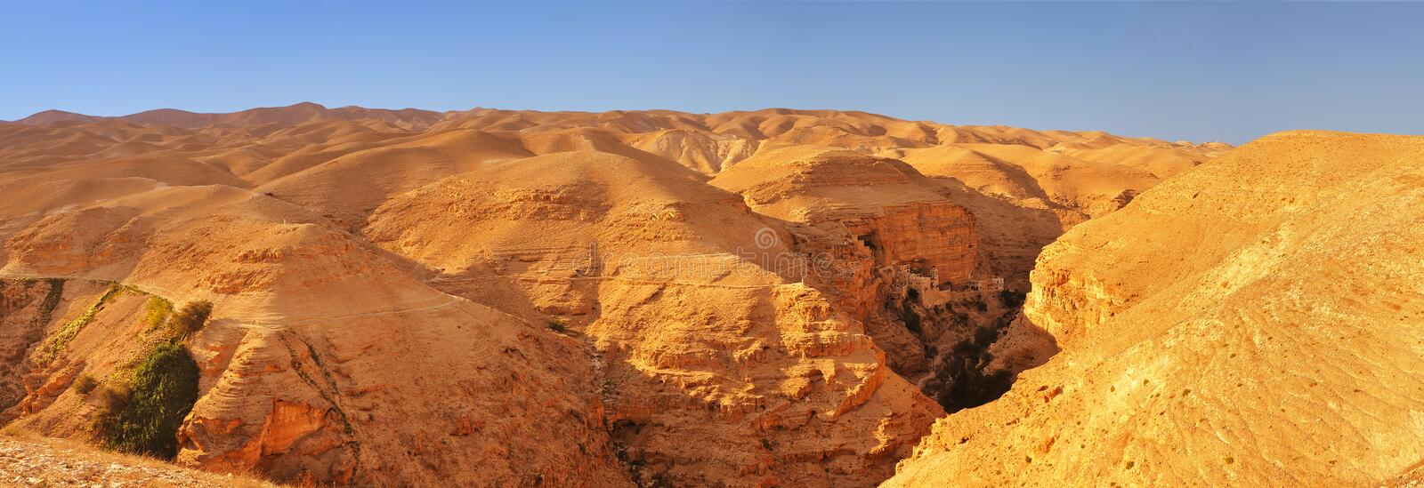Judean desert. Panoramic view towards the Monastery of Tempation, Greek Orthodox church in Jericho in the West Bank stock photo