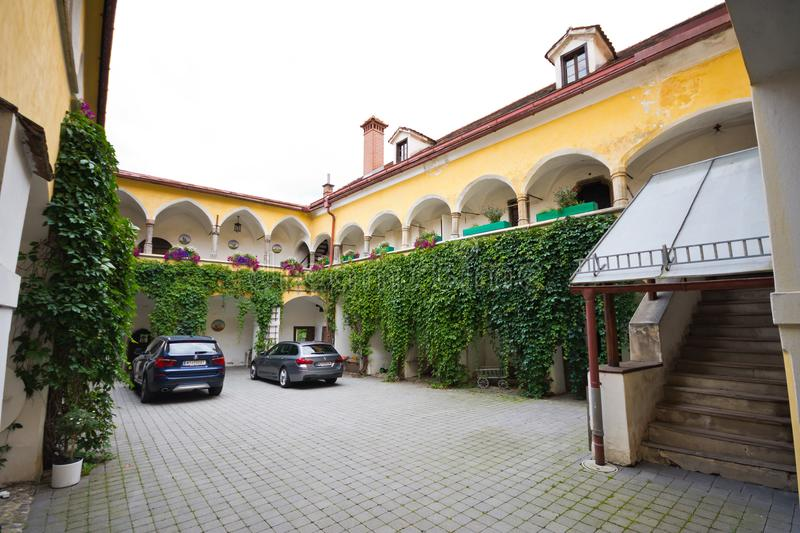 Courtyard arcades of medieval house stock image