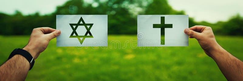 Judentum gegen Christentum lizenzfreies stockbild