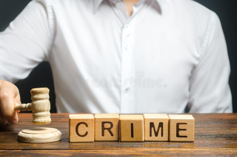 A judge adjudicates a crime. familiarization with court case. Litigation and choice of punishment. The judicial system. The rule of law. Resonant lawsuit stock photos