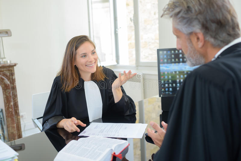 Judge and attorney having conversation royalty free stock photography