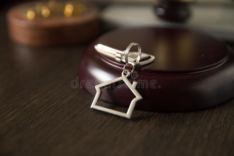 Judge Auctioneer Hammer, Door Key On Wooden Table. Concept For Court, Bankruptcy, Taxes, Mortgage, Auctions, Foreclosure. Or Inheritance Of Real royalty free stock photos