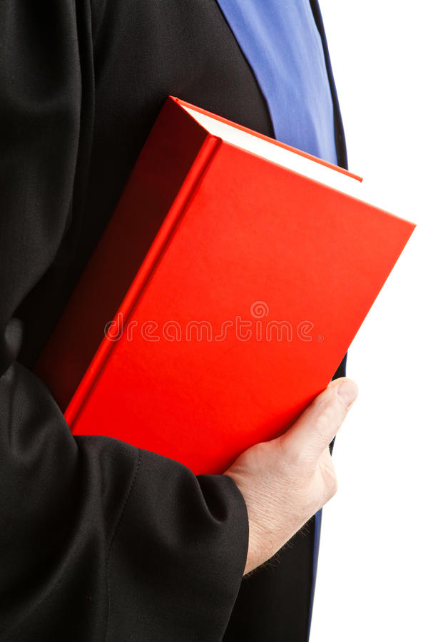 Judge in court with Code. A judge with a law book in court. Gavel in hand royalty free stock photos