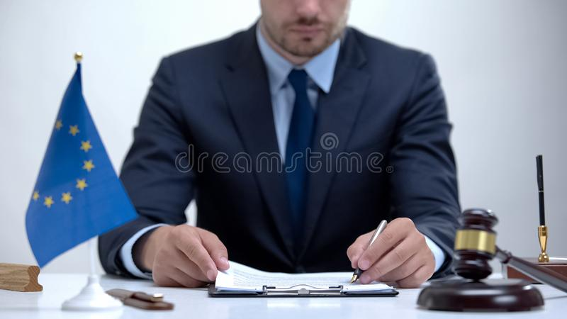 Judge of European supreme court checking evidence, protection of human rights royalty free stock photo