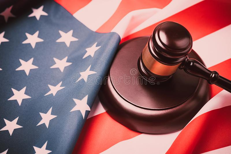 The judge gavel and background with usa flag royalty free stock photo