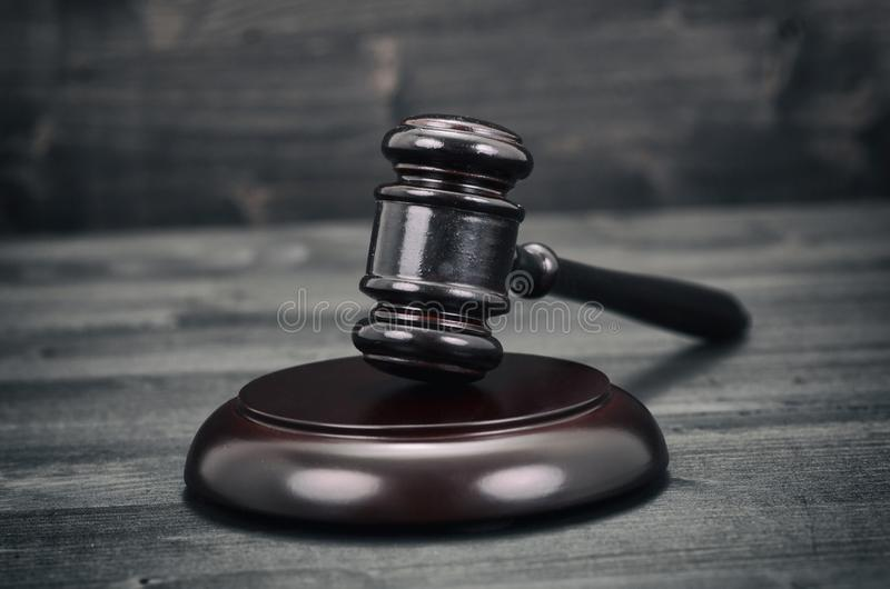 Judge Gavel on a black wooden background royalty free stock image