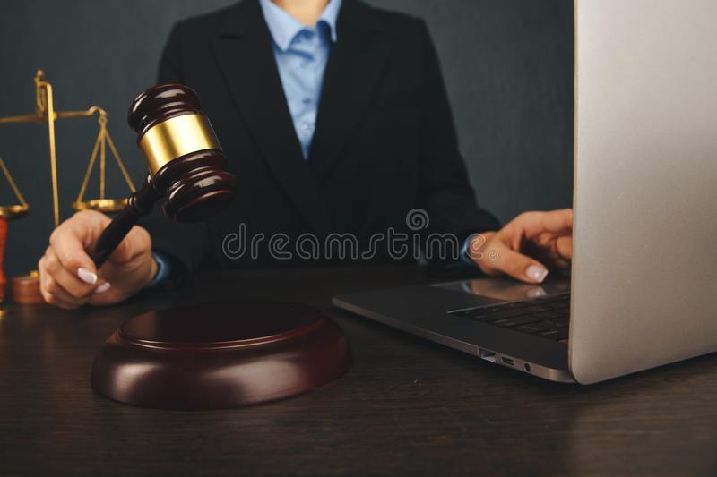 Judge gavel , books with attorney or lawyer provide legal advice and consoling to his clients in background. Divorce law stock photo