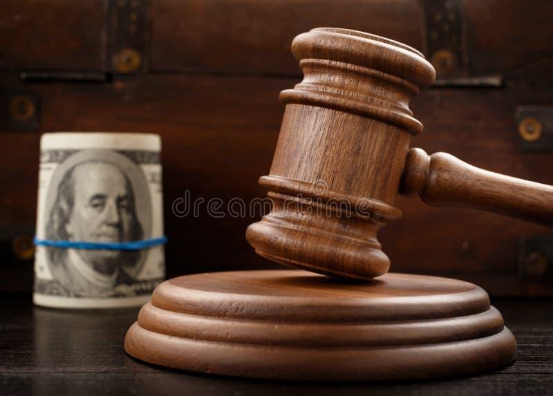 Judge gavel and bundle of hundred-dollar bills stock photo