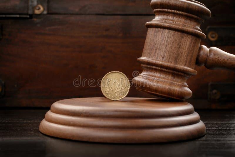 Judge gavel closeup with twenty eurocents stock photo