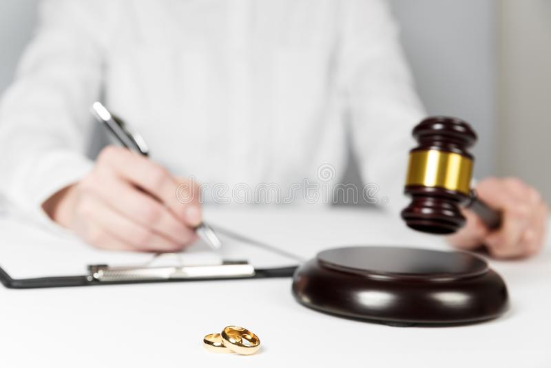 Judge gavel deciding on marriage divorce stock image