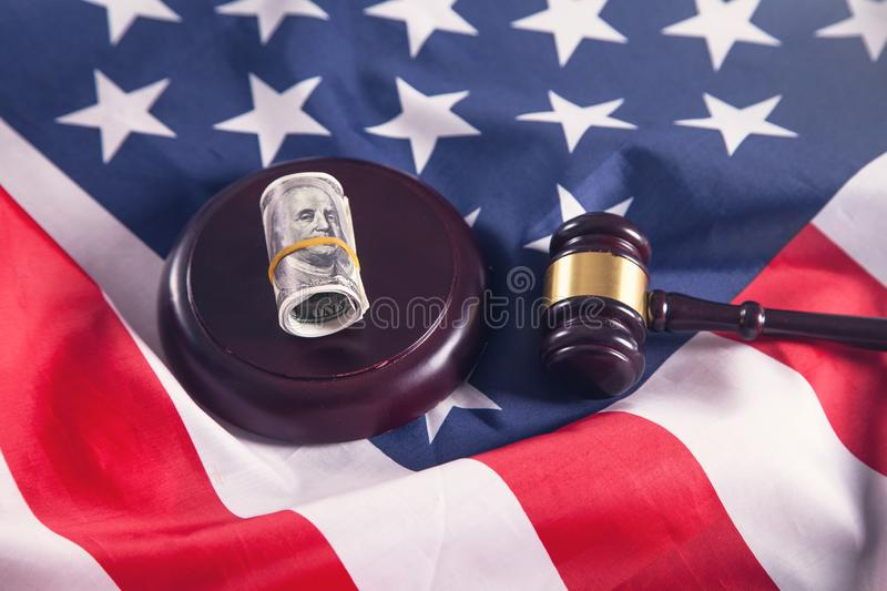 Judge gavel with dollars and American flag stock photo