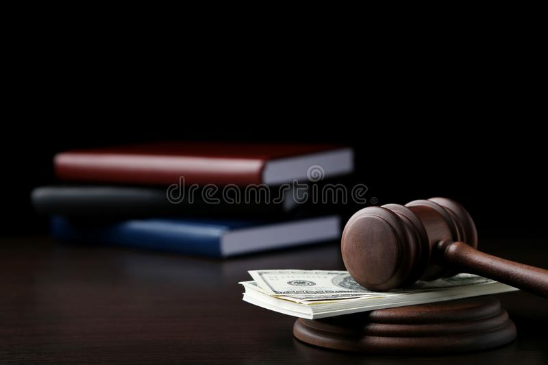 Judge gavel with dollars and books stock images