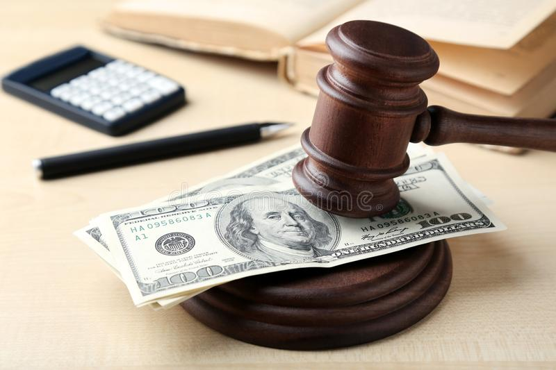 Judge gavel with dollars. On wooden table royalty free stock images