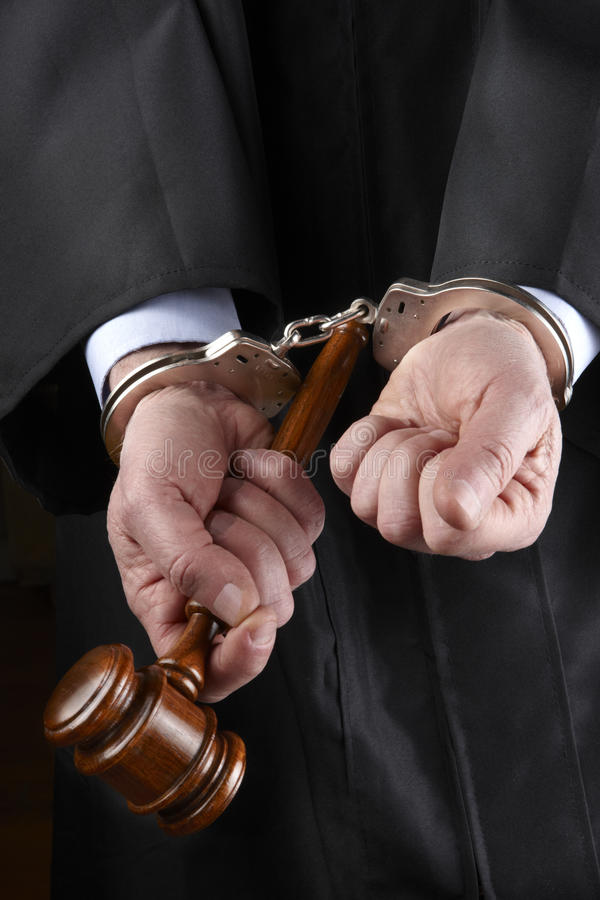 Judge with gavel in handcuffs royalty free stock photos