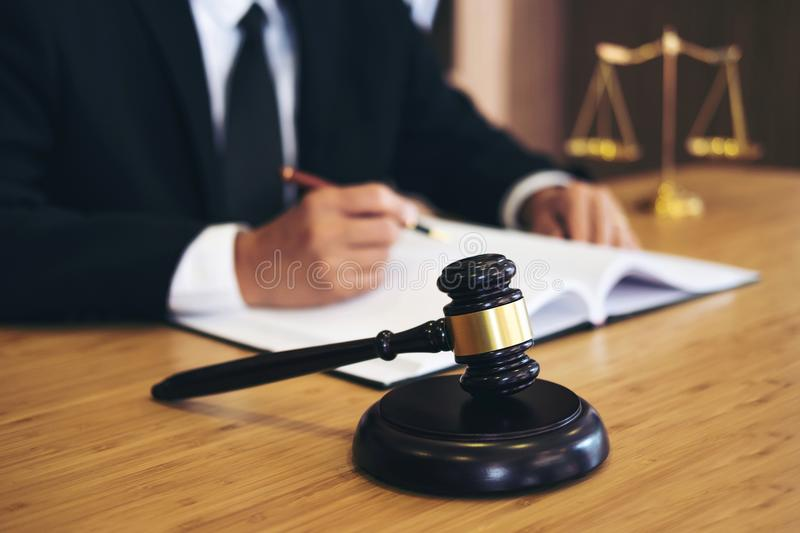 Judge gavel with Justice lawyers, Businessman in suit or lawyer. Working on a documents. Legal law, advice and justice concept stock photo