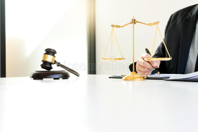 Judge gavel with Justice lawyers, Businessman in suit. Or lawyer working with legal law documents. advice and justice law firm concept royalty free stock photography