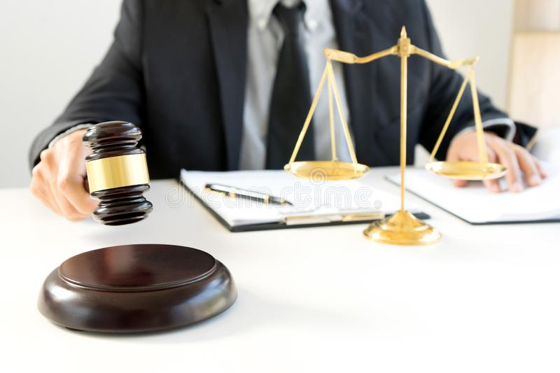 Judge gavel with Justice lawyers, Businessman in suit. Or lawyer working with legal law documents. advice and justice law firm concept stock image