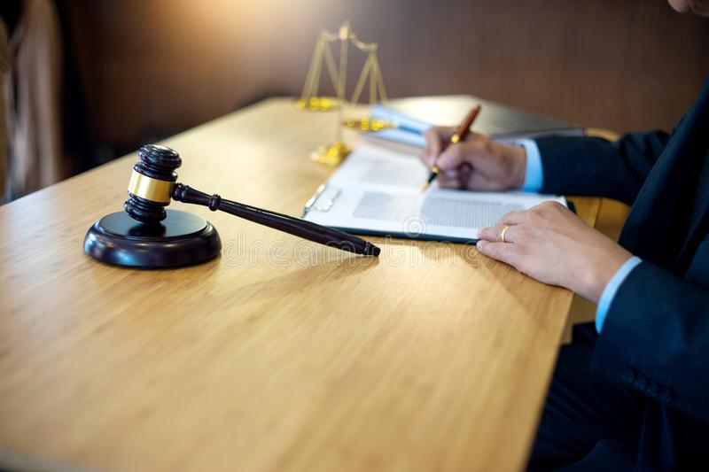 Judge gavel with Justice lawyers, Businessman in suit. Or lawyer working with legal law documents. advice and justice law firm concept stock photo