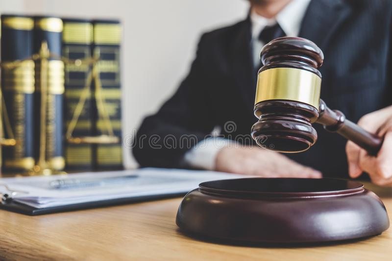 Judge gavel with Justice lawyers, counselor in suit or lawyer wo. Rking on a documents at law firm in office. Legal law, advice and justice concept royalty free stock photography