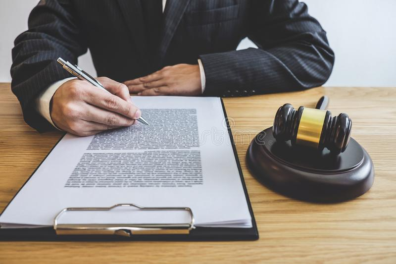 Judge gavel with Justice lawyers, counselor in suit or lawyer working on a documents at law firm in office. Legal law, advice and. Justice concept royalty free stock photography