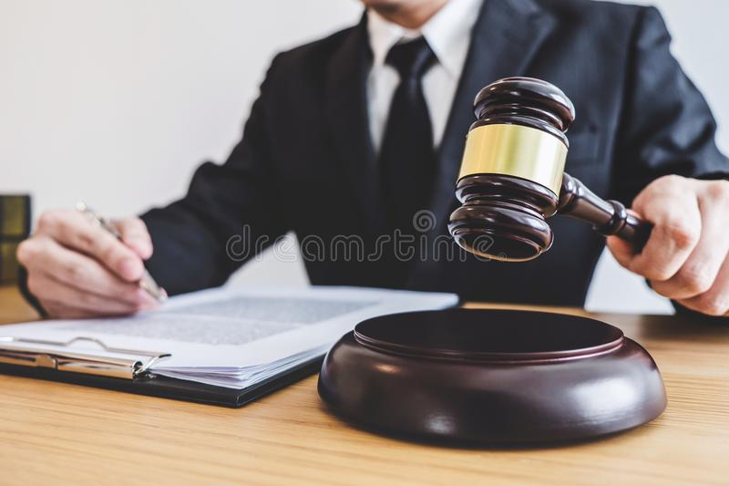 Judge gavel with Justice lawyers, counselor in suit or lawyer working on a documents at law firm in office. Legal law, advice and stock photo