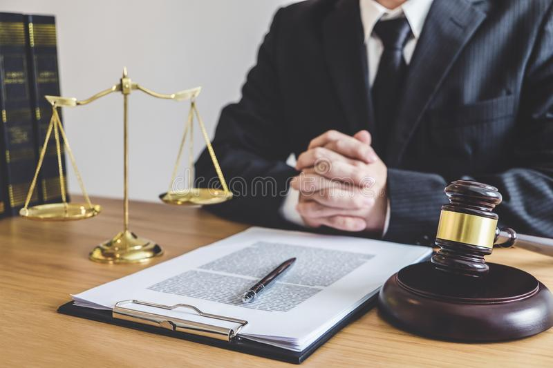 Judge gavel with Justice lawyers, counselor in suit or lawyer working on a documents at law firm in office. Legal law, advice and. Justice concept stock image