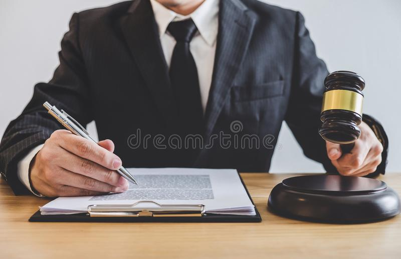 Judge gavel with Justice lawyers, counselor in suit or lawyer working on a documents at law firm in office. Legal law, advice and. Justice concept stock photography
