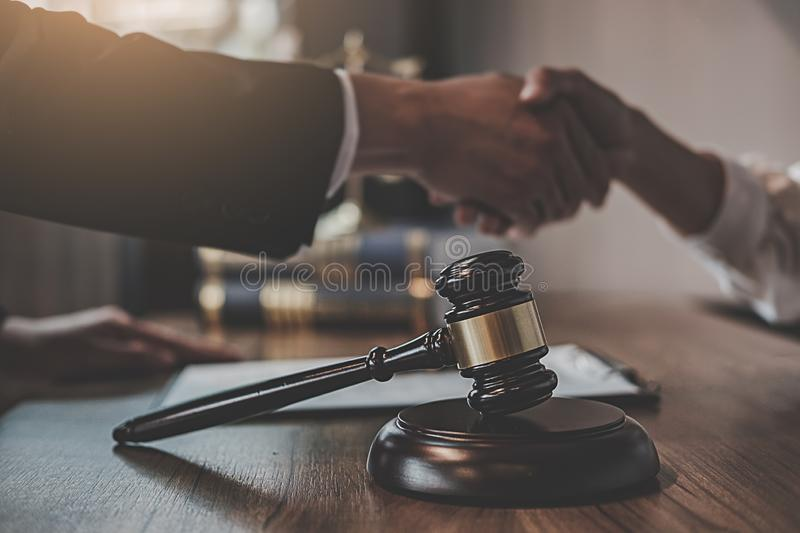Judge gavel with Justice lawyers having team meeting at law firm background. Concepts of Law and Legal services stock photo