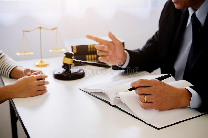 Judge gavel with Justice lawyers having team meeting at law firm. In background. Concepts of law stock image