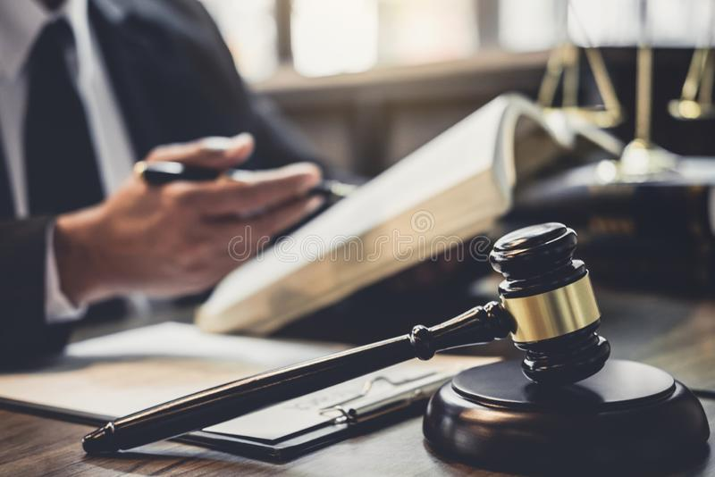 Judge gavel with Justice lawyers, Lawyer or Judge counselor working with agreement contract in Courtroom, Justice and Law concept.  stock photo
