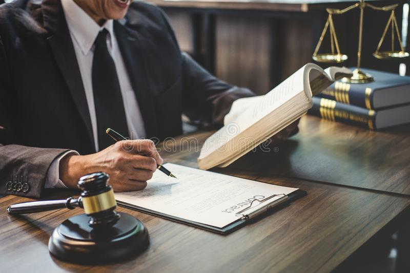 Judge gavel with Justice lawyers, Lawyer or Judge counselor working with agreement contract in Courtroom, Justice and Law concept.  royalty free stock image