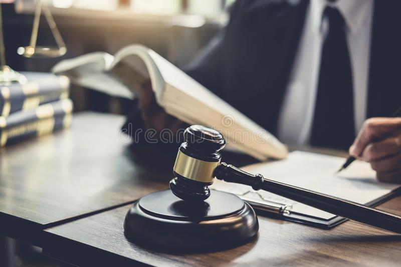 Judge gavel with Justice lawyers, Lawyer or Judge counselor working with agreement contract in Courtroom, Justice and Law concept.  royalty free stock images