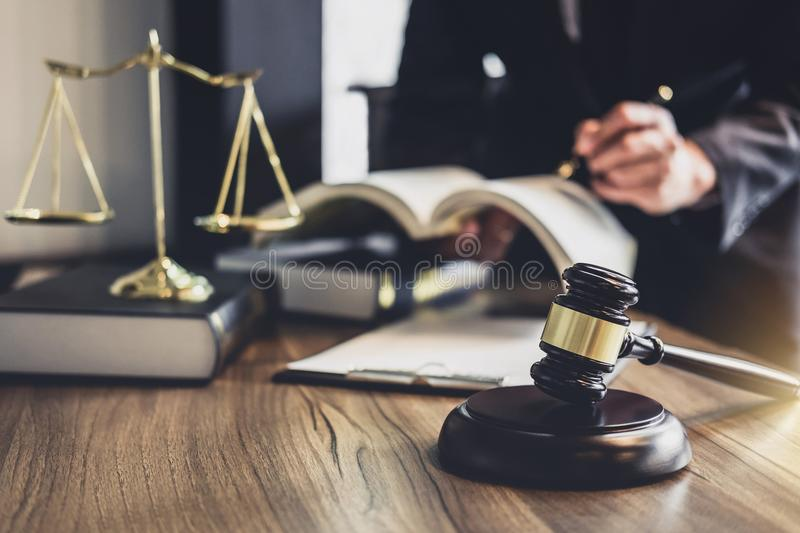 Judge gavel with Justice lawyers, Lawyer or Judge counselor work. Ing with agreement contract in Courtroom, Justice and Law concept stock photo