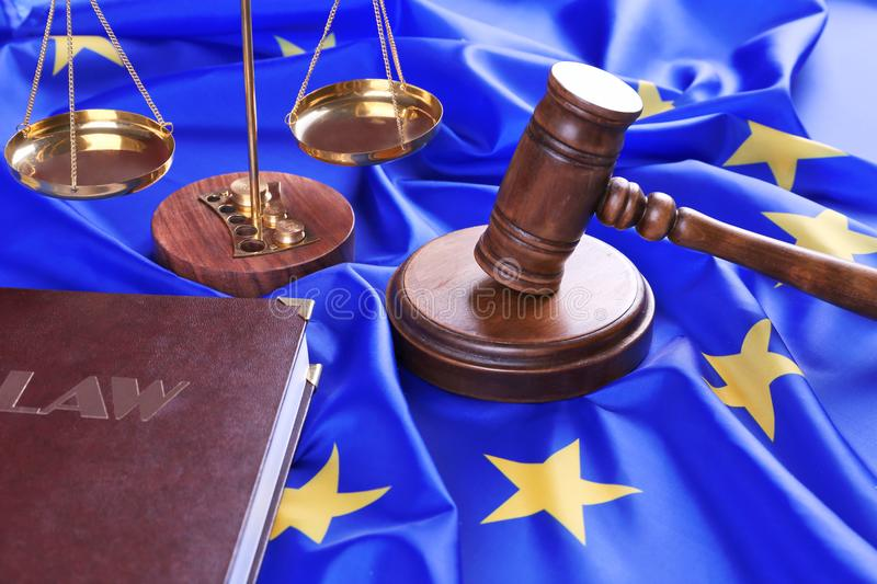 Judge gavel and law book with scales on European Union. Flag royalty free stock photography